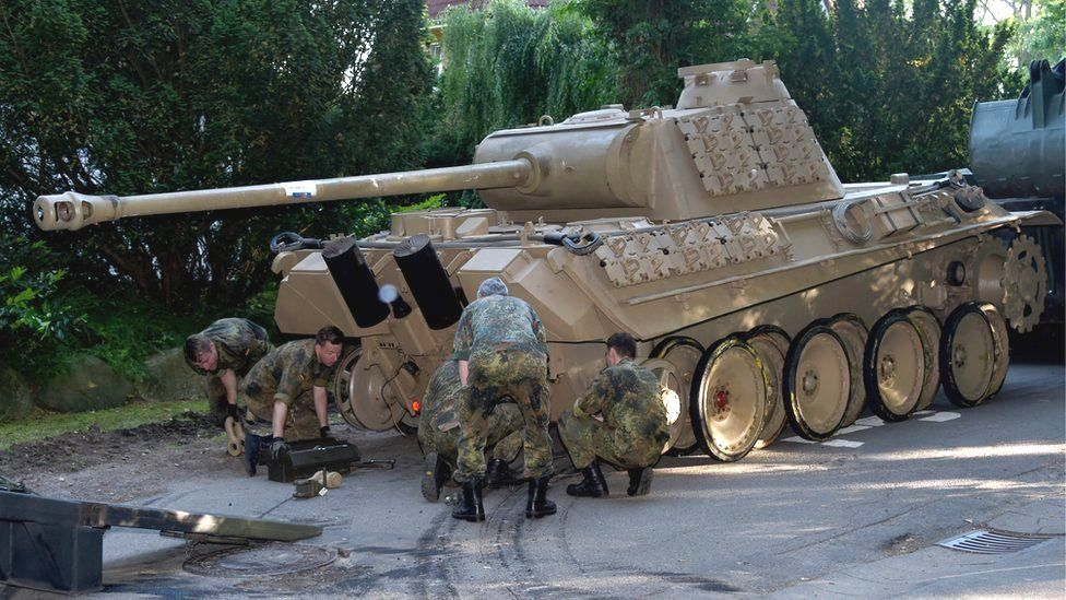 In Germany, a pensioner is tried for keeping a Panther tank in the basement of a house